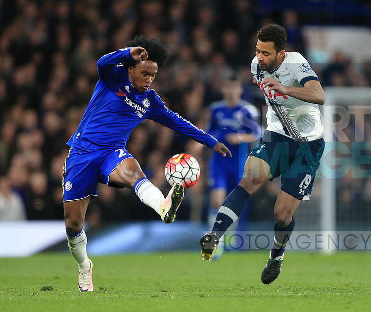 Chelsea's Willian tussles with Tottenham's Mousa Dembele during the Barclays Premier League match at Stamford Bridge Stadium.  Photo credit should read: David Klein/Sportimage