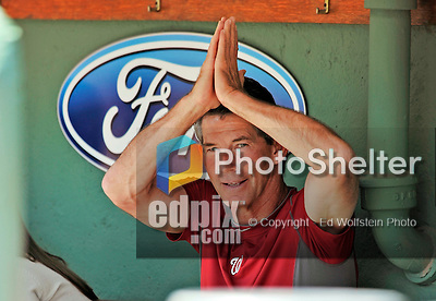 10 June 2012: Washington Nationals Bullpen Coach Jim Lett clowns in the dugout prior to a game against the Boston Red Sox at Fenway Park in Boston, MA. The Nationals defeated the Red Sox 4-3 to sweep their 3-game interleague series. Mandatory Credit: Ed Wolfstein Photo