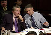 Washington, DC - April 8, 2004 -- Commissioners John F. Lehman, left, and Timothy J. Roemer, right, discuss the testimony of Doctor Condoleezza Rice, National Security Advisor, before the 9/11 Commission in Washington, D.C. on April 8, 2004.<br /> Credit: Ron Sachs / CNP<br /> [RESTRICTION: No New York Metro or other Newspapers within a 75 mile radius of New York City]