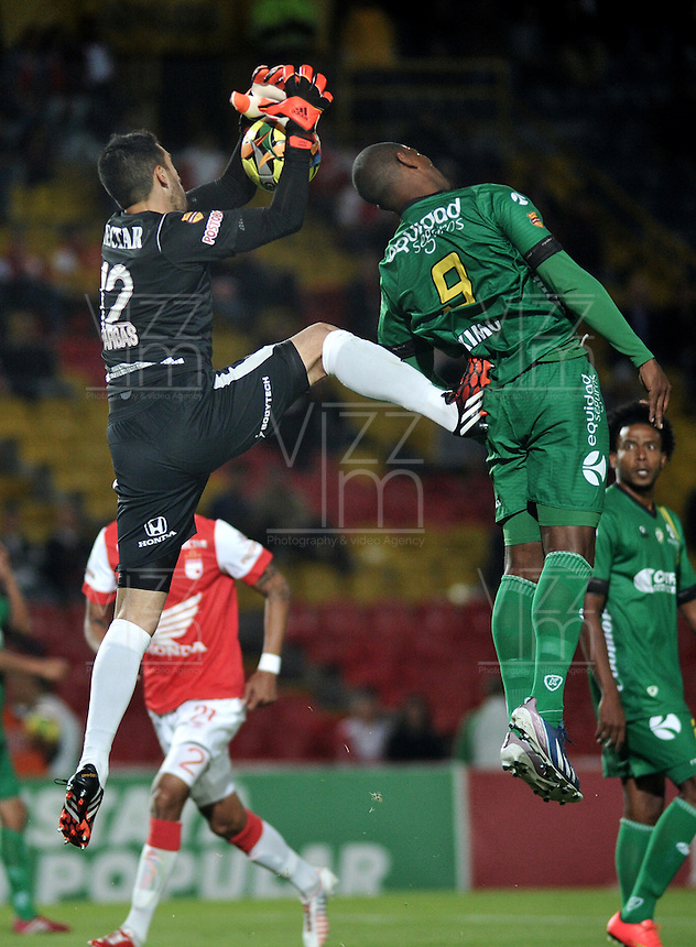 BOGOTA - COLOMBIA -24 -09-2014: Camilo Vargas (Izq.) Portero de Independiente Santa Fe disputa el balón con Jose Moreno (Der.) jugador de La Equidad durante partido entre Independiente Santa Fe y La Equidad por la fecha11 de la Liga Postobon II-2014, en el estadio Nemesio Camacho El Campin de la ciudad de Bogota. / Camilo Vargas (L) goalkeeper of Independiente Santa Fe struggles for the ball with Jose Moreno (R)  player of de La Equidad during a match between Independiente Santa Fe and La Equidad for the date 11 of the Liga Postobon II -2014 at the Nemesio Camacho El Campin Stadium in Bogota city, Photo: VizzorImage  / Luis Ramirez / Staff.