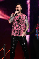 MIAMI, FL - AUGUST 07: Jordan McGraw performs during opening night of the Jonas Brothers 'Happiness Begins Tour' at the AmericanAirlines Arena on August 7, 2019 in Miami Florida. <br /> CAP/MPI04<br /> ©MPI04/Capital Pictures