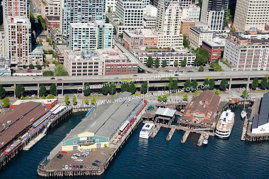 An aerial view of the downtown Seattle waterfront, the Columbia Street off-ramp, and middle portion of the Alaskan Way viaduct / Highway 99 just north of the Coleman Dock ferry terminal in downtown Seattle on a sunny summer day.