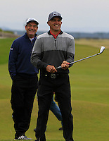Huey Lewis (AM) and Kelly Slater (AM) on the 17th fairway during the 2015 Alfred Dunhill Links Championship at the Old Course in St. Andrews in Scotland on 4/10/15.<br /> Picture: Thos Caffrey | Golffile