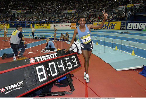 HAILE GEBRSELASSIE (ETH) celebrates winning the 2 mile race in a new world record time, Norwich Union Grand Prix, National Indoor Arena 030221 Photo:Neil Tingle/Action Plus...Athletics 2003.athlete man winner winners celebrate celebration celebrations joy finish distance clock