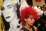 Punk girl with red hair &quot;Kings Road&quot; Chelsea shop assistant in Boy boutique, the image of the singer Marilyn is a t-shirt, displayed in sealed clear vinyl. London  England 1983.<br />
