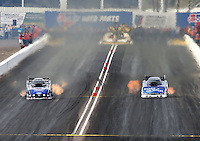 Feb 23, 2014; Chandler, AZ, USA; NHRA funny car driver Robert Hight (left) takes the win over Tommy Johnson Jr during the Carquest Auto Parts Nationals at Wild Horse Motorsports Park. Mandatory Credit: Mark J. Rebilas-USA TODAY Sports