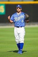 Adrian Morales #3 of the Burlington Royals warms up in the outfield prior to practice at Burlington Athletic Park on June 15, 2012 in Burlington, North Carolina.  (Brian Westerholt/Four Seam Images)