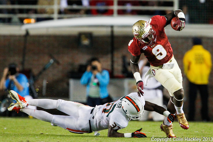TALLAHASSEE, FL 11/2/13-FSU-MIAMI110213CH-Florida State's Karlos Williams tip-toes by Miami's Ladarius Gunter during first half action Saturday at Doak Campbell Stadium in Tallahassee. <br /> COLIN HACKLEY PHOTO