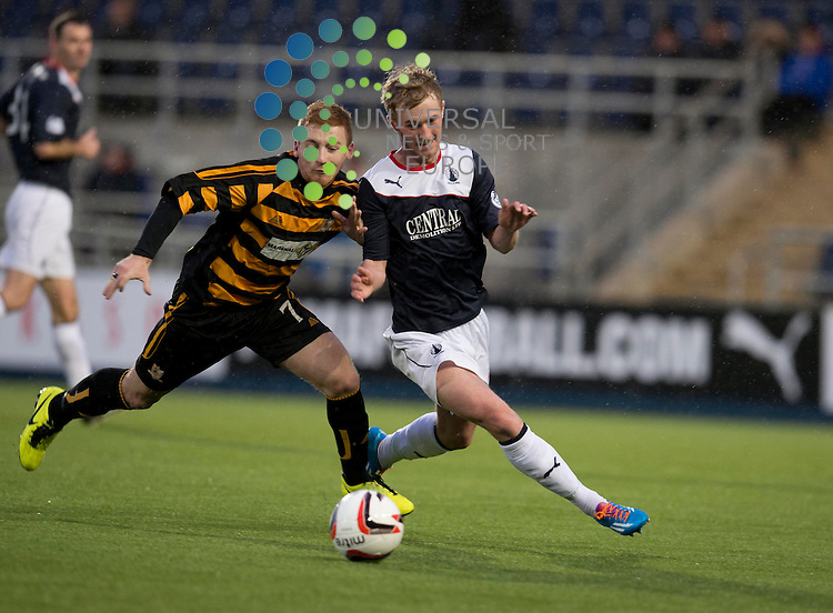 Liam Caddis of Alloa  challenges for the ball against Craig Sibbald of Falkirk during the Scottish Championship match between Falkirk and Alloa at The Falkirk Stadium, Falkirk. 28 December 2013. Picture by Ian Sneddon / Universal News and Sport (Scotland). All pictures must be credited to www.universalnewsandsport.com. (Office) 0844 884 51 22.