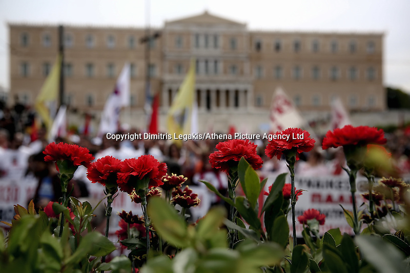Pictured: Red carnations outside the Greek Parliament Sunday 08 May 2016<br /> Re: Members of left wing parties gather outside the Greek Parliament, while MPs vote on pension and welfare reforms, Athens, Greece