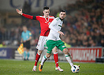 Tom Lawrence of Wales and Conor McLaughlin of Northern Ireland during the international friendly match at the Cardiff City Stadium. Photo credit should read: Philip Oldham/Sportimage