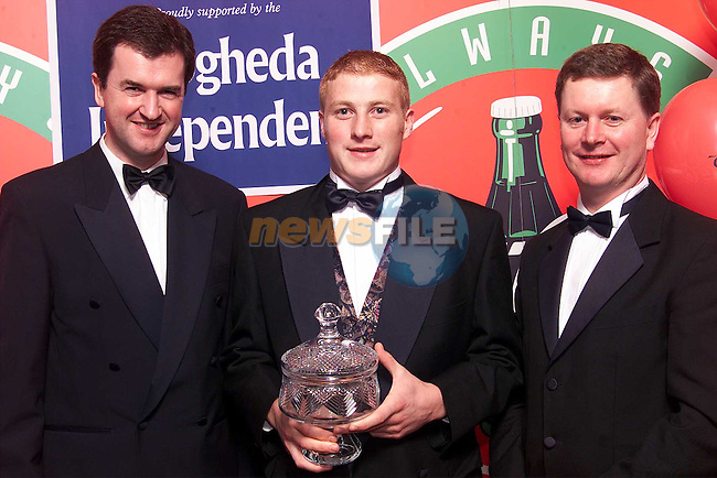 J.P. Rooney receiving the award for Drogheda Independent / Drogheda Concentrates Sportstar of the Year from Frank Mulrennan, Managing Director Drogheda Independent and Declan McCann, Drogheda Concentrates..Picture: Paul Mohan/Newsfile