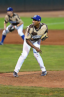 Ogden Raptors relief pitcher Jackson Mateo (33) delivers a pitch to the plate against the Great Falls Voyagers at Lindquist Field on August 16, 2013 in Ogden Utah. Military Appreciation Night saw the Raptors take the field in camouflage uniforms. (Stephen Smith/Four Seam Images)