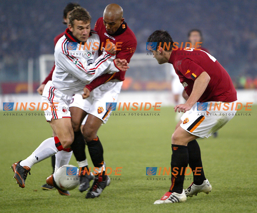 Roma 6/1/2004 Roma - Milan 1-2<br /> Andriy Shevchenko (Milan) challenged by Olivier Dacourt (Roma) and Christian Chivu (Roma)<br /> Photo Andrea Staccioli / Insidefoto