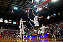 01 December 2010: Jackson State guard Phillip Williams (21) puts one up and over Nebraska guard Eshaunte Jones (1) at the Devaney Sports Center in Lincoln, Nebraska. Nebraska defeated Jackson State 76 to 57.