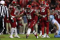 RALEIGH, NC - NOVEMBER 30: Alim McNeill #29 of North Carolina State University celebrates a sack during a game between North Carolina and North Carolina State at Carter-Finley Stadium on November 30, 2019 in Raleigh, North Carolina.