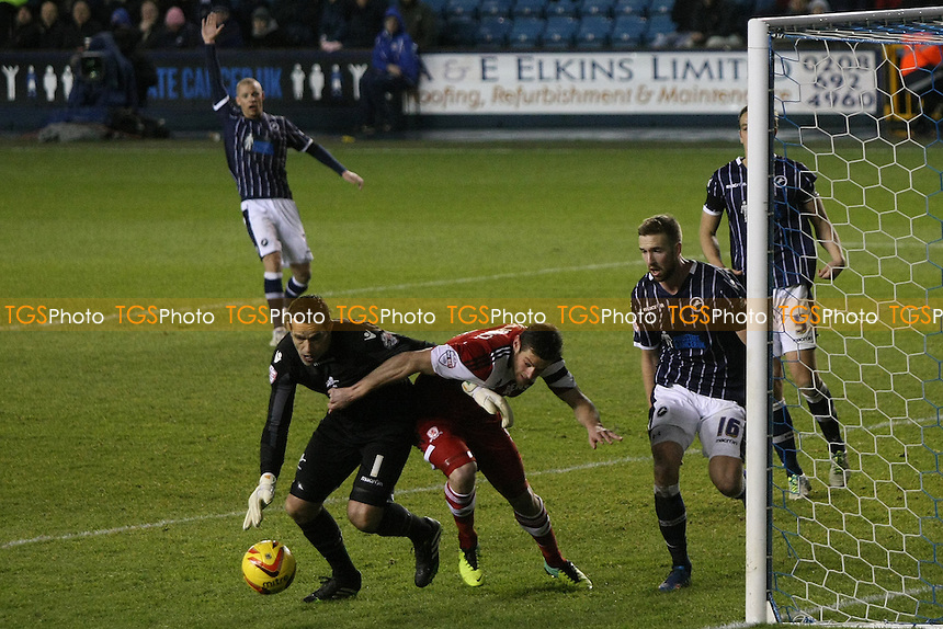 David Forde of Millwall smothers the ball from a Middlesbrough player - Millwall vs Middlesbrough - Sky Bet Championship Football at the New Den, Bermondsey, London - 21/12/13 - MANDATORY CREDIT: George Phillipou/TGSPHOTO - Self billing applies where appropriate - 0845 094 6026 - contact@tgsphoto.co.uk - NO UNPAID USE