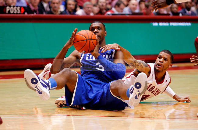 Terrence Jones fights for the ball on the floor with Kendall Durant in the second half of the UK men's basketball loss, 68-66, against the Alabama Roll Tide at Coleman Arena  on Jan. 18, 2011. Photo by Britney McIntosh | Staff