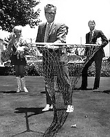Broadcaster Harry Caray with his famous net, behind him is Miss Oakland and A's pitcher Chuck Dobson.<br />