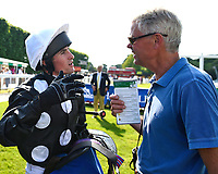 Excellent Sounds jockey Charlie Bennett talks through the race with trainer Hughie Morrison after winning The Cara Glass Fillies' Handicap (Class 5), during Father's Day Racing at Salisbury Racecourse on 18th June 2017