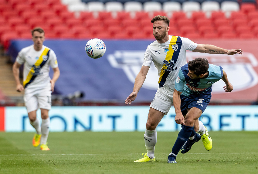 Wycombe Wanderers' Joe Jacobson (right) competing with Oxford United's James Henry  <br /> <br /> Photographer Andrew Kearns/CameraSport<br /> <br /> Sky Bet League One Play Off Final - Oxford United v Wycombe Wanderers - Monday July 13th 2020 - Wembley Stadium - London<br /> <br /> World Copyright © 2020 CameraSport. All rights reserved. 43 Linden Ave. Countesthorpe. Leicester. England. LE8 5PG - Tel: +44 (0) 116 277 4147 - admin@camerasport.com - www.camerasport.com