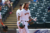 Hunter Tackett (21) of the Miami Hurricanes celebrates a run against the Georgia Tech Yellow Jackets during game one of the 2017 ACC Baseball Championship at Louisville Slugger Field on May 23, 2017 in Louisville, Kentucky. The Hurricanes walked-off the Yellow Jackets 6-5 in 13 innings. (Brian Westerholt/Four Seam Images)