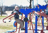 Jett Boyett, 5, of Fayetteville hangs from an outdoor gym set, Monday, January 20, 2020 at Luther George Park in Springdale. Check out nwaonline.com/200121Daily/ for today's photo gallery.<br /> (NWA Democrat-Gazette/Charlie Kaijo)