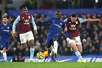 N'Golo Kante of Chelsea tries to shake off a challenge from Aston Villa's John McGinn during Chelsea vs Aston Villa, Premier League Football at Stamford Bridge on 4th December 2019
