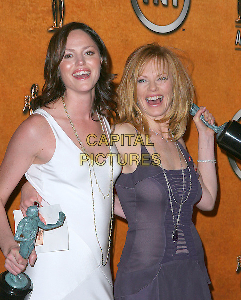 JORJA FOX & MARG HELGENBERGER.11th Annual Screen Actors Guild Awards (SAG) held at the Shrine Auditorium. Los Angeles, California.Photo Credit: Jacqui Wong/AdMedia.February 5th, 2005.half length award trophy purple dress chiffon sheer white dress, long gold silver chain necklace arm around waist .www.capitalpictures.com.sales@capitalpictures.com.© Capital Pictures.