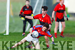 ISK's Rian O'Donavan been tackled by Brian Lynch of Bishopstown in the Frewen Cup in Currans on Friday.