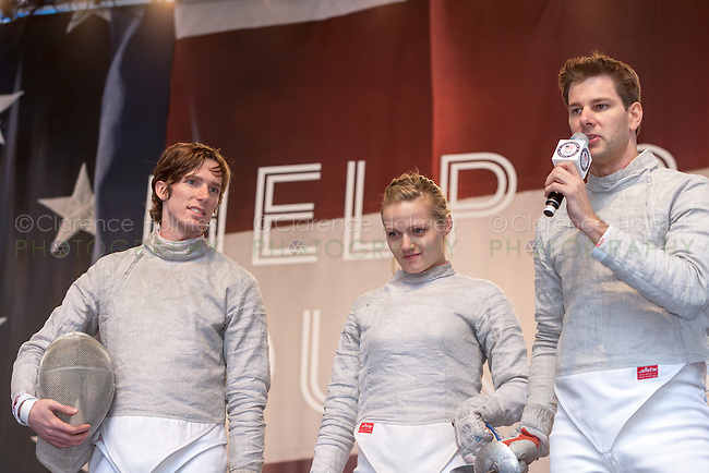 USA Olympic Fencing team members Jeff Spear (l) Dagmara Wozniak (c) and Tim Morehouse (r) participate in the Road to London 100 Days Out Celebration in Times Square in New York City, New York, USA on Wednesday, April 18, 2012.  Times Square was transformed into an Olympic Village for the event.