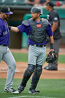 Catcher Drew Butera (16) and starting pitcher Antonio Senzatela (49) of the Albuquerque Isotopes walk off the field between innings of a game against the Salt Lake Bees at Smith's Ballpark on July 25, 2019 in Salt Lake City, Utah. The Bees defeated the Isotopes 8-3. (Stephen Smith/Four Seam Images)