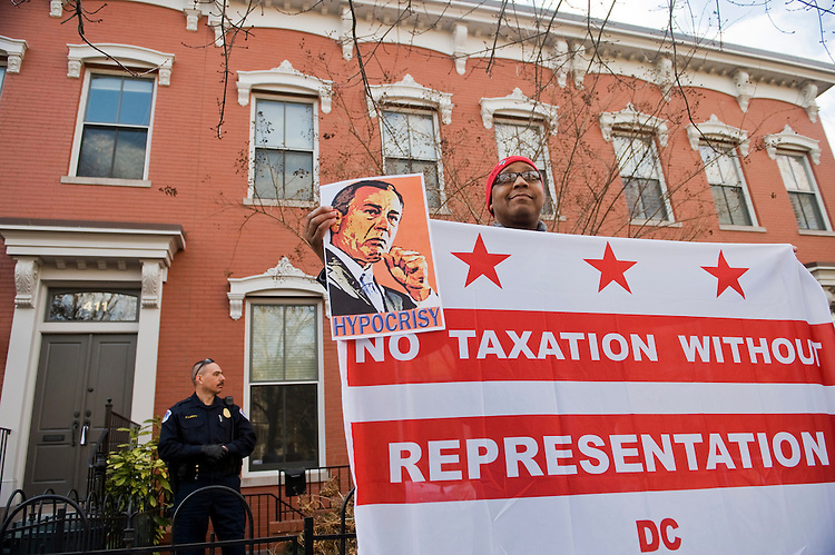 UNITED STATES - FEBRUARY 17:  Robert Brannum protests outside of the G St., SE, apartment of Speaker John Boehner, R-Ohio, during a rally with citizens who are unhappy with Congress's sway over local laws.  The protesters, organized by DC Vote, expressed dissatisfaction with issues such as the District's lack of representation in Congress and the defunding of reproductive services in the District.  (Photo By Tom Williams/Roll Call)