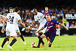 Arthur Melo of FC Barcelona (R) in action against Geoffrey Kondogbia of Valencia CF (C) during their La Liga 2018-19 match between Valencia CF and FC Barcelona at Estadio de Mestalla on October 07 2018 in Valencia, Spain. Photo by Maria Jose Segovia Carmona / Power Sport Images