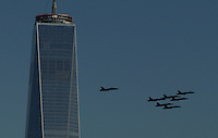 Seven F/A-18 Hornet combat jets from the Blue Angels flight demonstration squadron, flies over the Hudson River for promotional photographs featuring the One World Trade Center skyscraper in New York December 14  Photo by Kena Betancur / VIEWpress.
