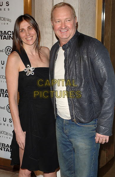 "RANDY QUAID & GUEST.At the premiere of ""Brokeback Mountain"" at the Mann National Theatre, Westwood, California, USA..November 29th, 2005.Ref: MOO.half length blue leather jacket black dress.www.capitalpictures.com.sales@capitalpictures.com.©Capital Pictures."