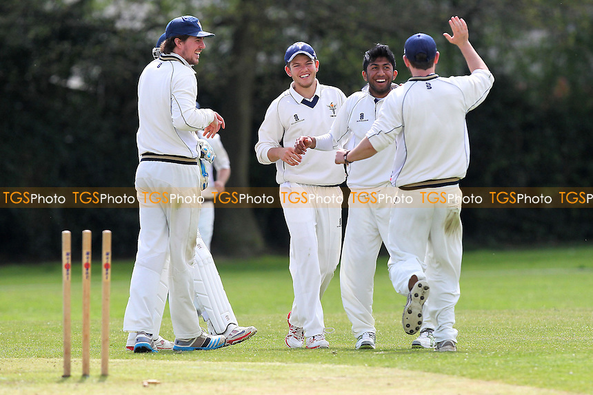 Rahul Patel of Chingford claims the wicket of Elliott Timoti - Upminster CC vs Chingford CC - Essex Cricket League Cup at Upminster Park - 25/04/15 - MANDATORY CREDIT: Gavin Ellis/TGSPHOTO - Self billing applies where appropriate - 0845 094 6026 - contact@tgsphoto.co.uk - NO UNPAID USE