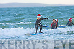 SURFING SANTA: Mark Mulvihill of the Ballybunion Surf Club riding the waves in aid of Crumlin Children's Hospital at Ballybunion beach on Sunday.