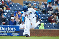 Dashenko Ricardo (30) of the Durham Bulls slaps hands with third base coach Brady Williams as he rounds the bases after hitting a home run against the Gwinnett Braves at Durham Bulls Athletic Park on April 20, 2019 in Durham, North Carolina. The Bulls defeated the Braves 11-3 in game one of a double-header. (Brian Westerholt/Four Seam Images)