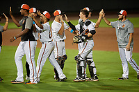 Delmarva Shorebirds Adley Rutschman (37) high fives Cody Roberts (14) after closing out a South Atlantic League game against the Greensboro Grasshoppers on August 21, 2019 at Arthur W. Perdue Stadium in Salisbury, Maryland.  Delmarva defeated Greensboro 1-0.  (Mike Janes/Four Seam Images)