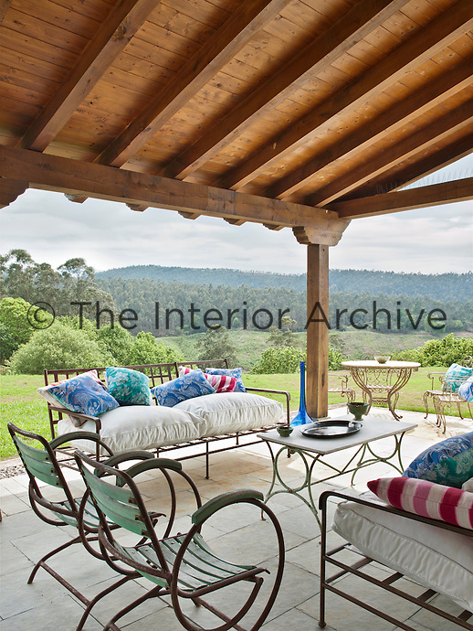 The covered terrace is the perfect spot to relax and enjoy the surrounding countryside.