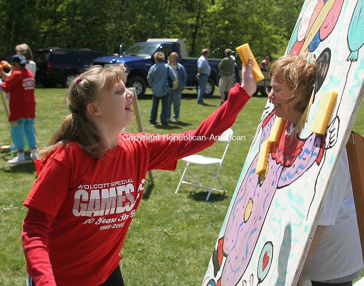 WOLCOTT, CT 15 May 2010 - 051510JW02.jpg -- Wolcott Special Games contestant Alexis Valencourt adds an extra splash to her teacher, Special Games volunteer Bobbi Thompson during the 21st Annual Wolcott Special Games Saturday morning at the Woodtick Recreation area. Jonathan Wilcox Republican-American