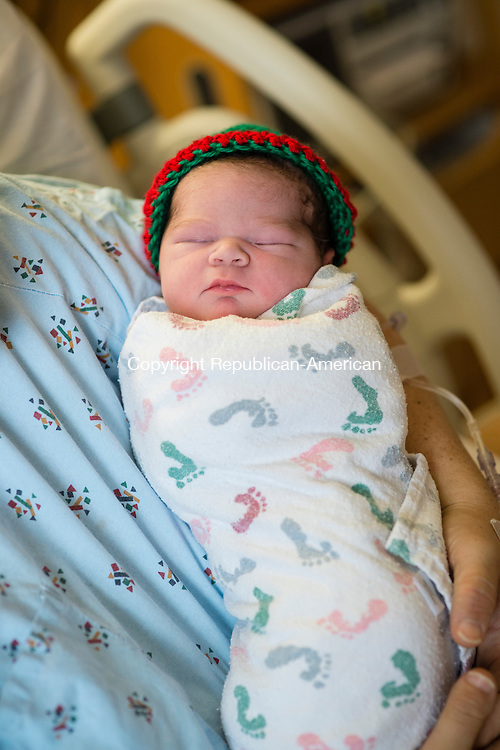 WATERBURY, CT - 1 January 2016-010116EC05--    Julie Arriola of Bethlehem holds her newborn son, Luis Antonio, the second baby born in Waterbury. Waterbury Hospital welcomed the first two babies of 2016 in the city early Friday morning. Erin Covey Republican-American.