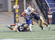 Annapolis, MD - October 7, 2017: Air Force Falcons running back Timothy McVey (33) gets tackled by several Navy Midshipmen defenders during the game between Air Force and Navy at  Navy-Marine Corps Memorial Stadium in Annapolis, MD.   (Photo by Elliott Brown/Media Images International)