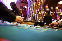 Players gamble at a roulette game at the Grand Lisboa casino in Macau, China, on February 23, 2008. Macao has overtaken Las Vegas with a gambling revenue of 7 billion U.S. dollars in 2006 (Las Vegas' was 6.6 billion U.S. dollars), and is now the world's top casino hut. Photo by Lucas Schifres/Pictobank