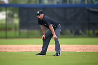 Umpire Chad Westlake during a Gulf Coast League game between the GCL Astros and GCL Nationals on August 9, 2019 at FITTEAM Ballpark of the Palm Beaches training complex in Palm Beach, Florida.  GCL Nationals defeated the GCL Astros 8-2.  (Mike Janes/Four Seam Images)