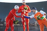SCHAATSEN: BOEDAPEST: Essent ISU European Championships, 07-01-2012, Podium 500m Men, Zbigniew Brodka POL, Konrad Niedzwiedzki POL, Jan Blokhuijsen NED, ©foto Martin de Jong