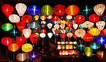A lantern shop in Hoi An at night, located along the street that features the night market.
