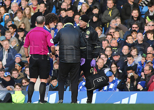 11.12.2016. Stamford Bridge, London, England. Premier League Football. Chelsea versus West Bromwich Albion. Referee Mike Dean stops play after Chelsea Defender David Luiz receives a blow to his ear
