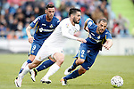 Getafe's Alvaro Vazquez (l) and Mehdi Lacen (r) and Real Madrid's Isco Alarcon during La Liga match. April 16,2016. (ALTERPHOTOS/Acero)